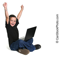 Excited Young Kid Working on Lap Top Computer - Excited...