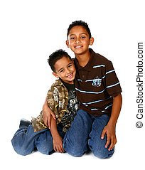 Hispanic Brothers Smiling and Hugging on White Background