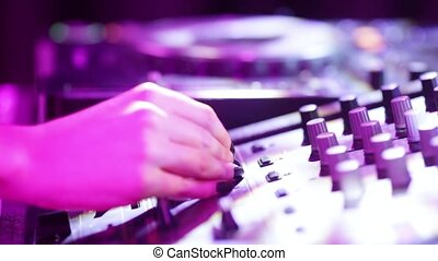 DJ booth - Female DJ and her hands on DJ mixer