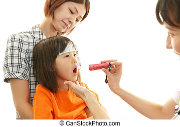 Asian medical doctor and child - Doctor checking the throat...