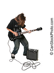 Teenager Playing Electric Guitar With Amplifier