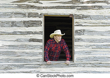 Cowboy Looking Out a Window - Handsome cowboy or rancher...