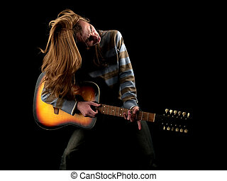 Heavy Metal - Young long hair guitarist plays hard rock
