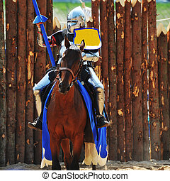 knights tournament - armored medieval knight on horseback at...