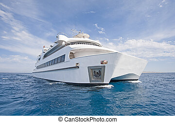 Large luxury catamaran at sea - Large steel luxury private...