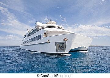 Large luxury catamaran at sea - Large steel luxury private...