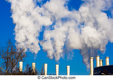 Air pollution - Factory with chimneys and white smoke,...