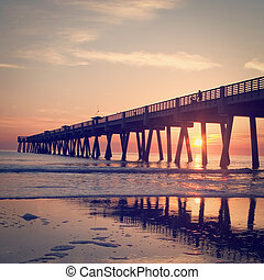 Fishing Pier - A Big Long Fishing Pier at Sunrise with retro...