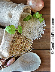 white rice and brown rice in canvas bags