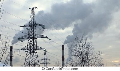 power transmission line - Power line on background smoking...