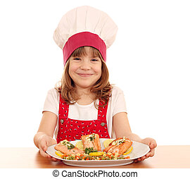 happy little girl cook with salmon seafood