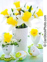 narcissi in vase and eggcups - Easter decoration: narcissi...