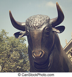 Bull - Close up of a Bull Statue in public area with retro...