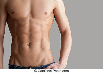 Workout results. Cropped image of muscular man standing...