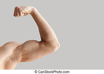 Perfect shape. Cropped image of muscular man showing his...