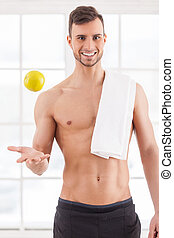 Join healthy lifestyle! Handsome young muscular man with...