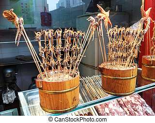 Scorpion satay in Wang Fu Jing - Fresh scorpion and starfish...