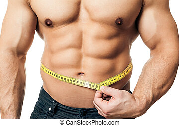 measure body - An image of a handsome young muscular sports...
