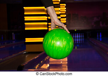 Bowling ball - bowling ball in the hand of player