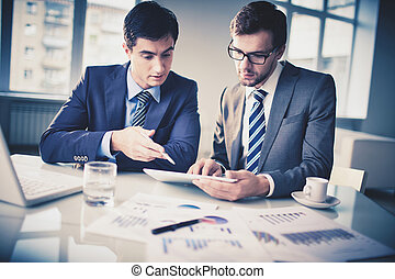 New project - Image of two young businessmen discussing new...