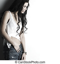 Portrait of beautiful sexual girl in jeans, standing near a...