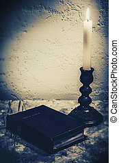 Spiritual abstract still life with Holy Bible on the desk...