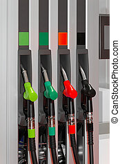 Fuel station - Color coded fuel nozzles at petrol station