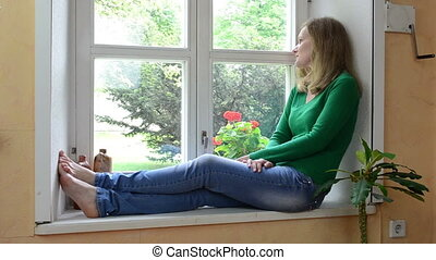 woman read book sill - wife woman sit on sill and watch...