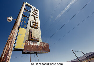 Hotel sign ruin along historic Route 66 in the middle of...