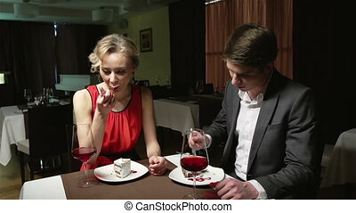 Sweet Lovers - Romantic lovers enjoying their dessert while...