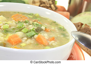 Barley porridge with vegetable on a light background