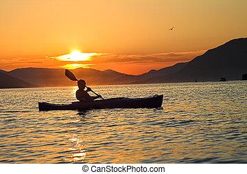 Kayaking in Montenegro - Summer sunset kayaking in...