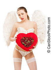 young blond woman in angel costume holding heart