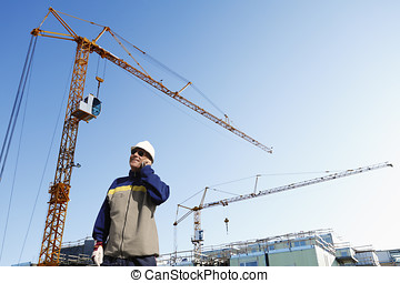 building worker and constructions - building worker talking...