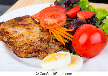 Grilled beef steak with salad