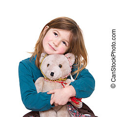 Cute girl hugging teddy bear - Close up portrait of a cute...