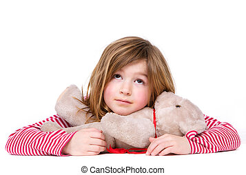 Adorable young girl relaxing with teddy bear - Close up...