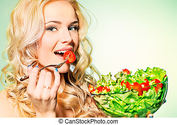natural food - Portrait of a beautiful young woman eating...