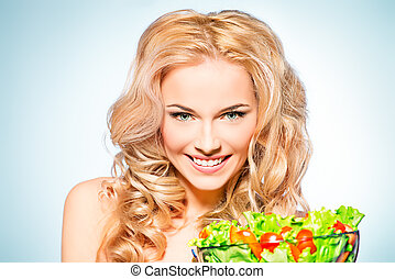 happy eating - Portrait of a beautiful young woman eating...