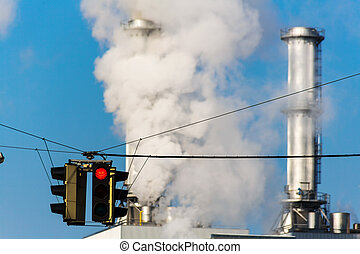 industrial chimney and red traffic lights - chimney of an...