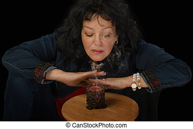 Mature woman blows out the candle - Mature woman in denim...