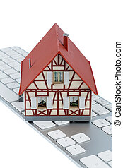 residential house on keyboard symbol photo for home purchase...