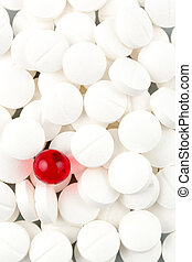 tablets in white and red - white tablets in contrast with a...