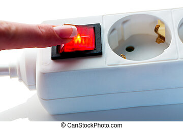 hand with switch for power - a manual switch for the...
