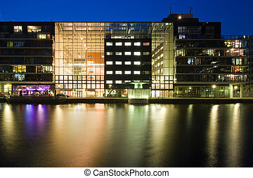 Illuminated office exterior - The glass facade of a brightly...