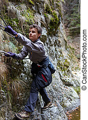 Teenager boy climbing - Teenage boy climbing the mountain...