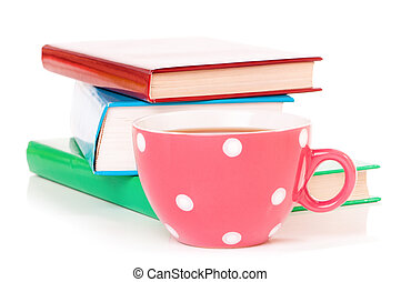 Cup of tea - Big mug polka dot of tea and books, isolated on...