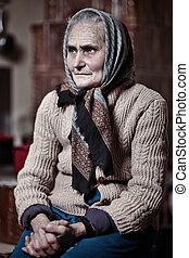 Old woman indoors - Old woman with kerchief indoors with...