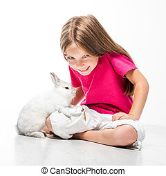 little girl with her rabbit - Cute little girl with her...