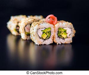 rolls over black - Sushi rolls over black background